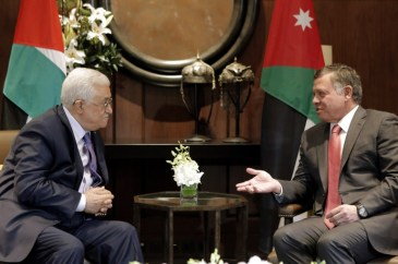 Jordan's King Abdullah II (R) talks with Palestinian president Mahmud Abbas before a meeting at the Royal Palace in Amman on November 12, 2014. Abbas is also to meet Washington's top diplomat John Kerry to discuss the upsurge in violence in east Jerusalem and the West Bank, his spokesman told AFP . AFP PHOTO/KHALIL MAZRAAWI